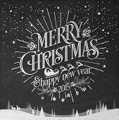 stock photo of merry  - Merry Christmas And New Year Typographical Background On Blackboard With Chalk - JPG