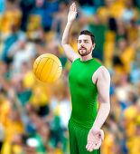 foto of volleyball  - Volleyball player on green uniform on volleyball court - JPG
