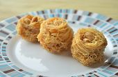pic of baklava  - Closeup of birds nest baklava dessert with peanuts - JPG