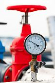 foto of manometer  - manometer and red valve on hot pipe - JPG