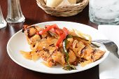 foto of poblano  - a plate of Chicken asada with red and green peppers and onions - JPG