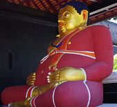 picture of apparel  - Side angle view of a gold Buddha in red apparel which almost fills the room - JPG