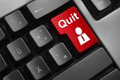 stock photo of quit  - dark grey keyboard with red button employee quit - JPG
