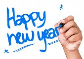 stock photo of happy new year 2014  - Happy new year written on a transparent board - JPG
