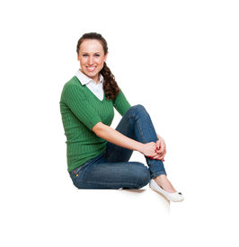 pic of smiley face  - smiley young woman sitting on white copyspace - JPG