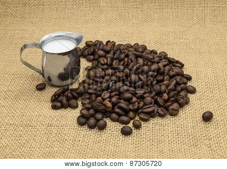 Coffee Beans And Milk Jug