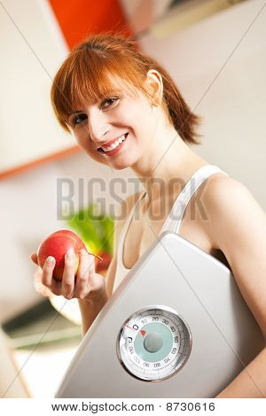 loosing weight - woman with scale and apple