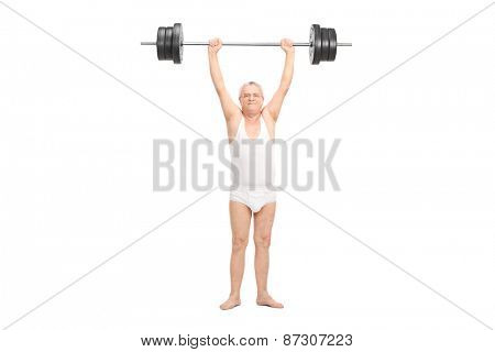 Studio shot of a semi-dressed senior lifting a heavy barbell and looking at the camera isolated on white background