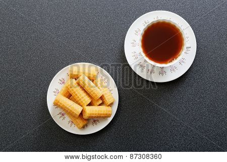 Waffer Rolls And Cup Of China Tea. Top View.