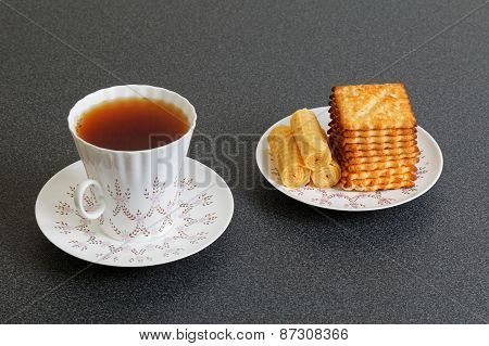 Cookies Rolls And Cup Of China Tea