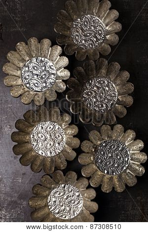 abstract picture with Vintage Baking Tins or molds on dark metal background