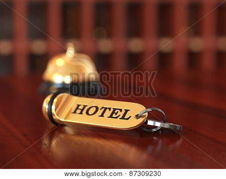 Room Access Key And Bell On Wooden Reception Desk. Soft Focus Illustration