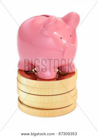 Small Piggy Bank On Top Of Golden Coins. Money And Business Concept