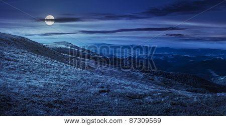 Valley On Hillside Of Mountain Range At Night