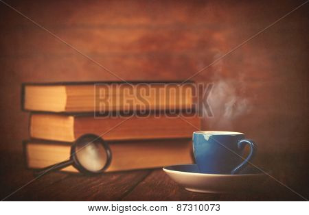 Cup Of Coffee And Book With Loupe