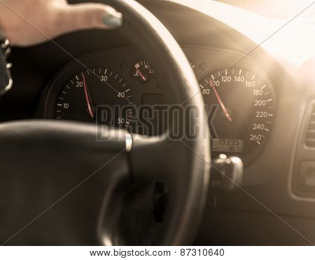 Driver in car holding steering wheel