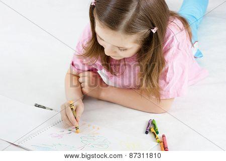Girl Draws Lying On The Floor