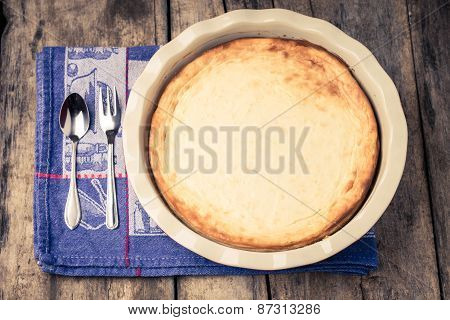 Fresh Baked Cheesecake On Wooden Table.