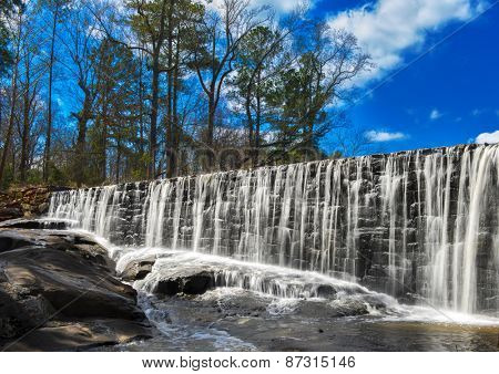 Beautiful water fall on a sunny summer day