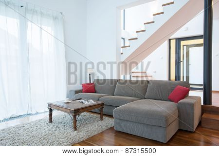 Large Sofa In Spacious Living Room