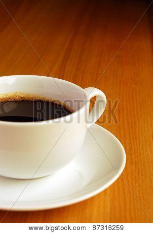 Black Coffee on Oak Desk