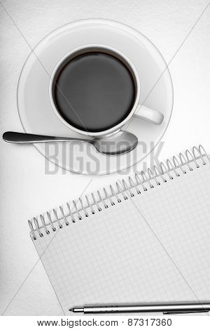 Notepad,  pen and  cup of coffee