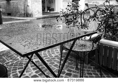 Bar table under the rain. Black and white image