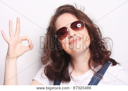 Successful young girl gives thumb up with two hands