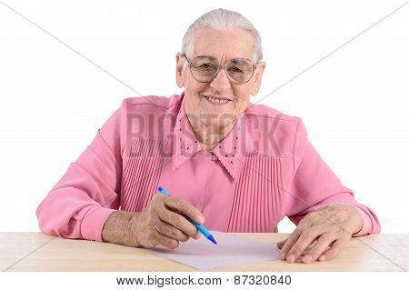 Elderly Woman Writes The Document