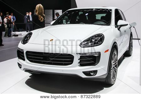 NEW YORK - APRIL 1: Porsche exhibit Cayenne S hybrid at the 2015 New York International Auto Show during Press day,  public show is running from April 3-12, 2015 in New York, NY.