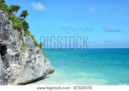 Picturesque Rock Covered With Little Palm Trees And Tropical Vegetation At Turquoise Blue Sea Coast