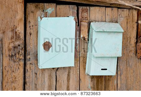 Old post boxes on the wooden wall of slum house in Astrakhan, Russia.