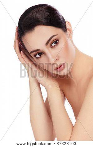 Young beautiful healthy thoughtful woman touching her face over white background