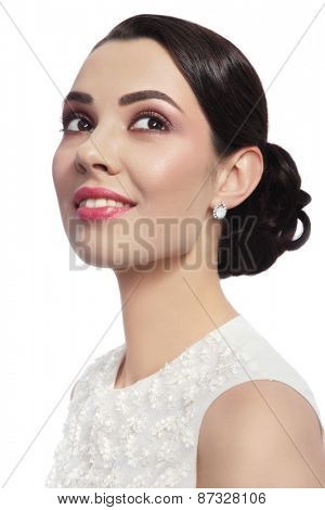 Young beautiful happy smiling bride with stylish make-up and hairdo over white background