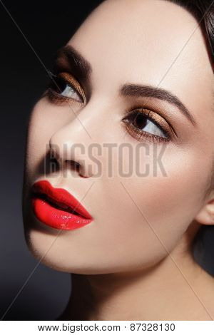 Close-up shot of woman's face with red lips and stylish make-up