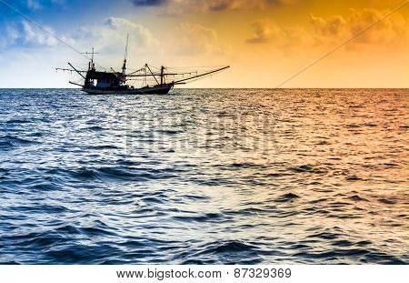 Fishing Boat On The Water At Sunset
