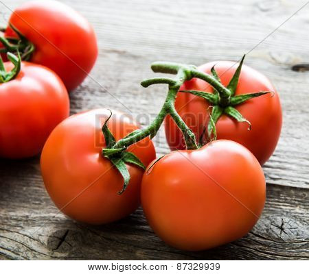 fresh tomatoes  on a dark wooden table