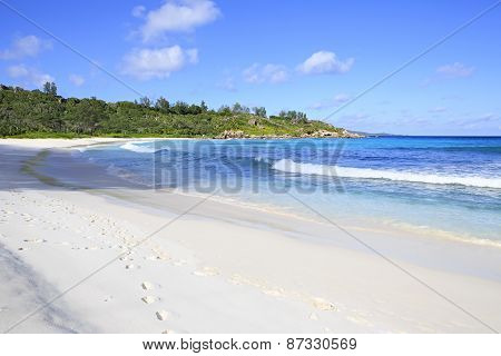 Beautiful Indian Ocean on the beach Anse Cocos.