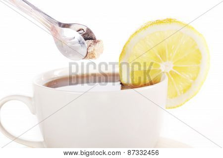 Full Cup Of Tea With Lemon