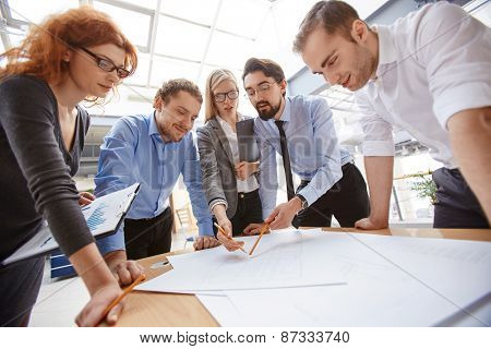 Businessman explaining project to his colleagues at meeting