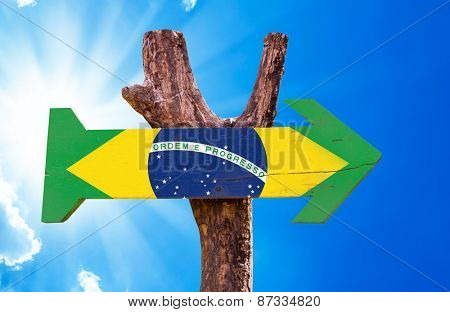 Brazil Flag wooden sign with sky background