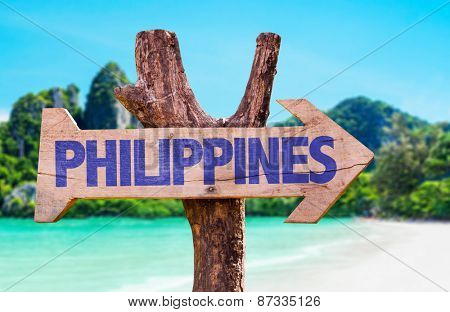 Philippines wooden sign with beach background