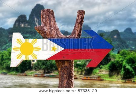 Philippines Flag wooden sign with rural background