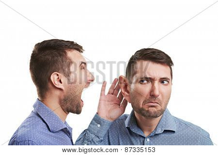 young businessman with big ear listening angry screaming man. isolated on white background