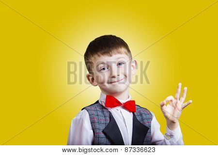 Funny Little boy making Ok sign