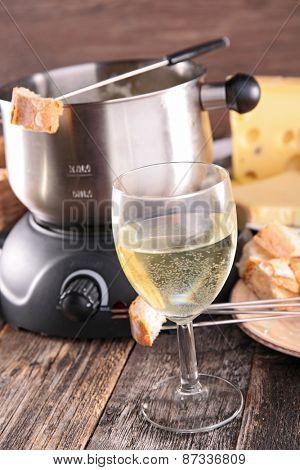 wine glass and cheese fondue