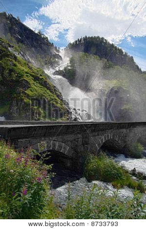 Great Waterfall With A Bridge In The Foreground