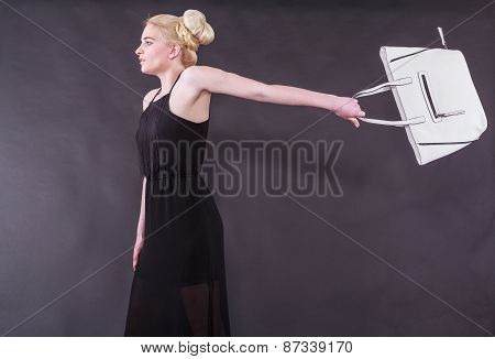 spirited young blond woman with purse
