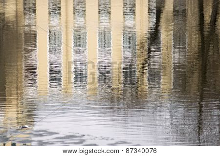 Reflection Of The Building In Water Ripples