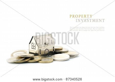 Property Investment, Silver Golden House Model On Coins Isolated On White